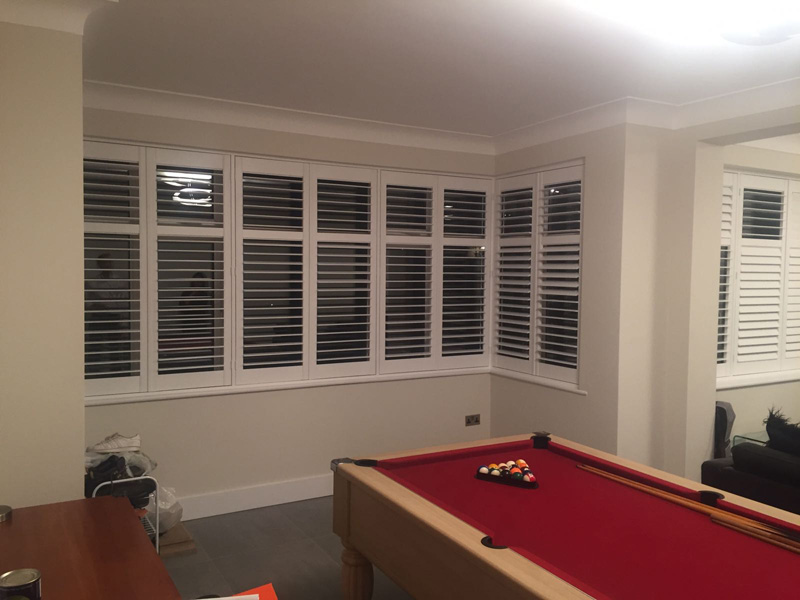 Hardwood plantation shutters. Made to measure and fitted to this London games room and lounge area.