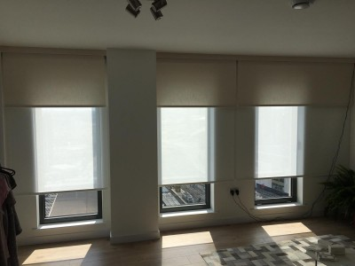 Electric double roller blinds fitted at a property in Stratford, London. For a free survey and estimate call us today.
